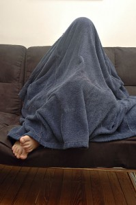 hiding under blanket